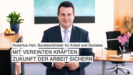 """Bild von Hubertus Heil mit der Aufschrift: """"Hubertus Heil, Bundesminister für Arbeit und Soziales. Mit vereinten Kräften: Zukunft der Arbeit sichern""""."""