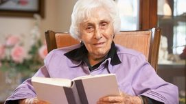 Elderly Woman reading a book Opens page: Pensions from age 67