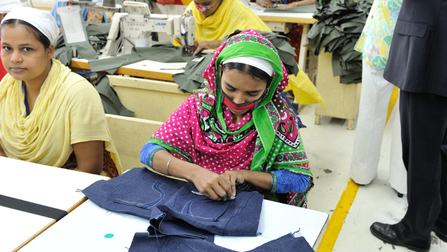 "Two young women at work in a garment factory in bangladesh. Opens page: Promoting decent work worldwide: G7 ""Standards in Supply Chains"" initiative"