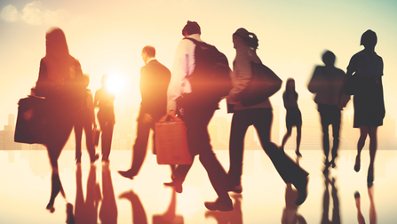 Several business people walking in front of a sunrise. Opens page: Mobility within the EU – Information about the Legal framework, free movement of workers, access to social benefits and benefit entitlement exceptions