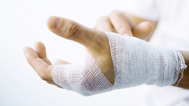 Bandaged hand Opens page: Statutory occupational accident insurance