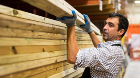 A worker raises wooden slats. Opens page: The Integration Act