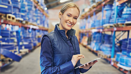 Woman holding a Tablet while standing in a warehouse Opens page: Labour market