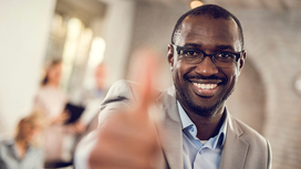 man laughing showing thumbs up Opens page: Recognition of your qualifications