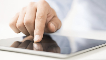 Hand on a tablet. Opens page: EGF media library – Here you find informations on the European Globalisation Adjustment Fund