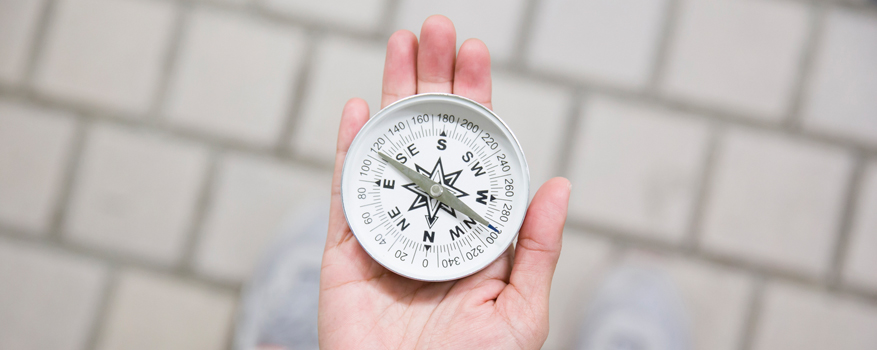 A compass in a woman's hand.